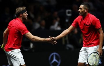 PRAGUE, CZECH REPUBLIC - SEPTEMBER 22:  Nick Kyrgios playing with Jack Sock of Team World celebrates winning a point during there doubles match against Tomas Berdych and Rafael Nadal of Team Europe on the first day of the Laver Cup on September 22, 2017 in Prague, Czech Republic.  The Laver Cup consists of six European players competing against their counterparts from the rest of the World. Europe will be captained by Bjorn Borg and John McEnroe will captain the Rest of the World team. The event runs from 22-24 September.  (Photo by Clive Brunskill/Getty Images for Laver Cup)