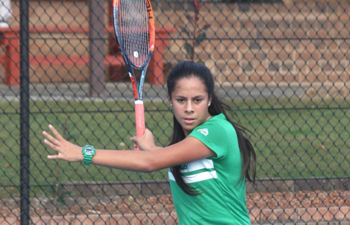 Angelina Teakaraanga hits a forehand during the 14/U State Championships in Gosford NSW