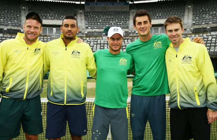 SYDNEY, AUSTRALIA - SEPTEMBER 17:  (l-R) Sam Groth, Nick Kyrgios, Bernard Tomic and John Peers of Australia with captain of Australian Lleyton Hewitt (C) pose after winning the Davis Cup World Group playoff between Australia and Slovakia at Sydney Olympic Park Tennis Centre on September 17, 2016 in Sydney, Australia.  (Photo by Matt King/Getty Images)