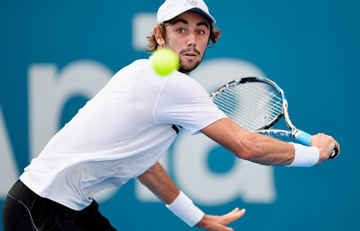 SYDNEY, AUSTRALIA - JANUARY 10:  Jordan Thompson of Australia plays a backhand shot in his first round match against Nikoloz Basilashvili of Georgia during day three of the 2017 Sydney International at Sydney Olympic Park Tennis Centre on January 10, 2017 in Sydney, Australia.  (Photo by Brett Hemmings/Getty Images)