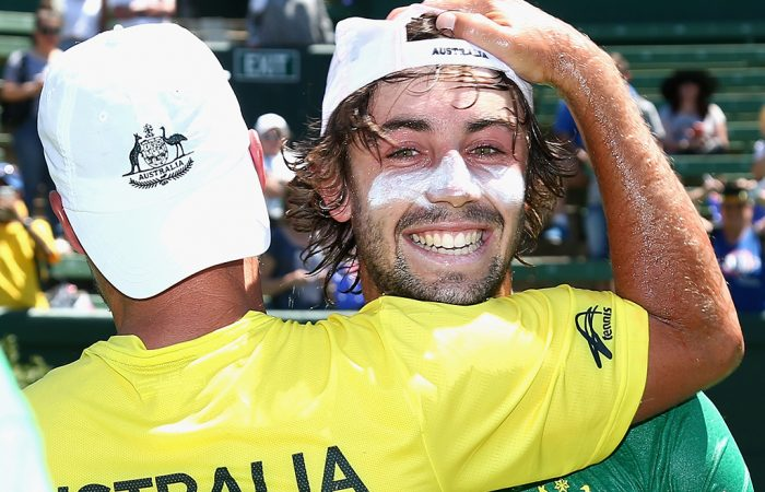 MELBOURNE, AUSTRALIA - FEBRUARY 04:  Jordan Thompson of Australia is congratulated after winning the tie against Czech Republic during the first round World Group Davis Cup tie between Australia and the Czech Republic at Kooyong on February 4, 2017 in Melbourne, Australia.  (Photo by Robert Prezioso/Getty Images)