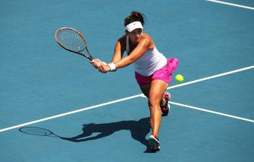 HOBART, AUSTRALIA - FEBRUARY 08:  Casey Dellacqua of Australia plays a backhand in her singles match against Irina Khromacheva of Russia during the Fed Cup tie between Australia and Russia on February 8, 2014 in Hobart, Australia.  (Photo by Mark Nolan/Getty Images)