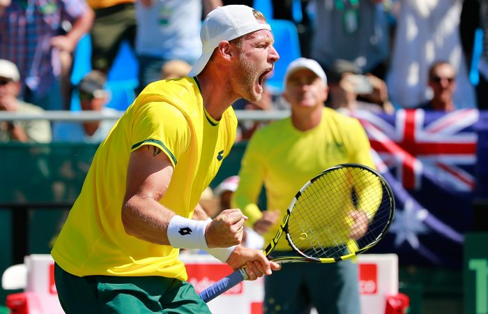 DARWIN, AUSTRALIA - JULY 18:  Sam Groth of Australia celebrates winning a point as Wally Masur, captain of Australia  looks on as Sam Groth and Lleyton Hewitt of Australia play Andrey Golubev and Aleksandr Nedovyesov of Kazakhstan in the doubles during day two of the Davis Cup World Group quarterfinal tie between Australia and Kazakhstan at Marrara Sporting Complex on July 18, 2015 in Darwin, Australia.  (Photo by Scott Barbour/Getty Images)
