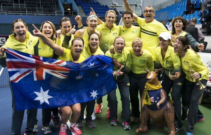 Australia's Fed Cup team celebrates its 3-2 victory over Slovakia in Bratislave to advance to the World Group Play-offs; Roman Benicky