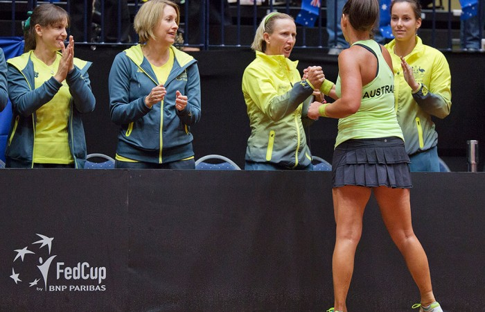 Casey Dellacqua shakes hand with Australian coach, Nicole Pratt after winning the second singles rubber of the Netherlands vs Australia Fed Cup World Group Play-off tie; Henk Koster
