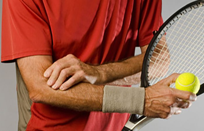CY94GR male tennis player with tennis elbow