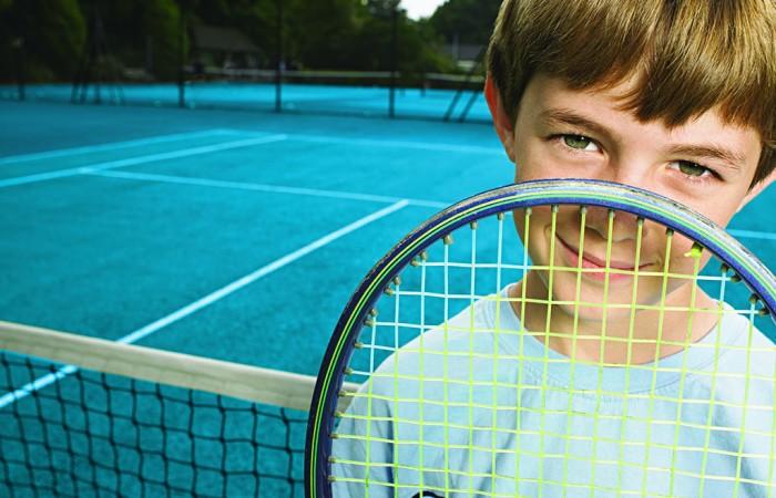 Boy with tennis racket