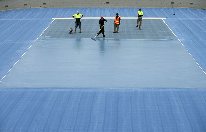 MELBOURNE, AUSTRALIA - NOVEMBER 13:  A blue surface court is layed onto Margaret Court Arena ahead of the 2008 Australian Open at Melbourne Park on November 13, 2007 in Melbourne, Australia. (Photo by Kristian Dowling/Getty Images)
