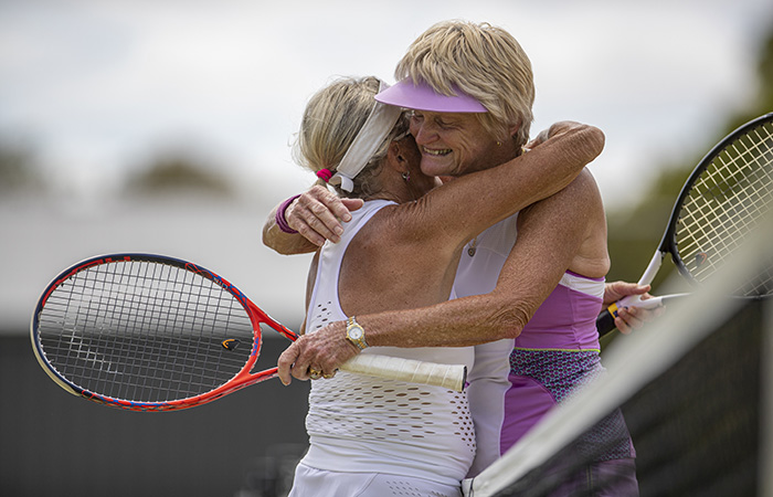 Over 70's Winner Adrienne Avis  and Runner up Kerry Ballard embrace after a close fought match.