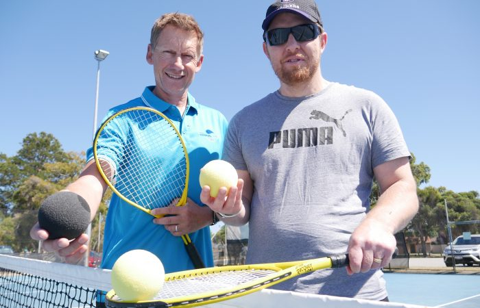 Vision impaired tennis at the net