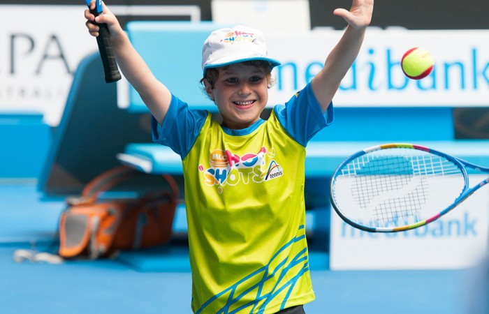 A hearing-impaired player enjoys a Hot Shots session on court at Australian Open 2014. JAIMI CHISHOLM