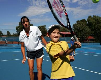 Female coach and boy