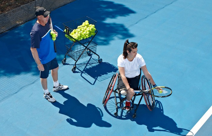 Coach Greg Crump passes on some tips to a wheelchair tennis player. TENNIS AUSTRALIA