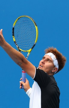 MELBOURNE, AUSTRALIA - DECEMBER 09:  Dane Propoggia of Australia serves during his Australian Open 2012 Play-offs quarterfinal match against Greg Jones of Australia at Melbourne Park on December 9, 2011 in Melbourne, Australia.  (Photo by Scott Barbour/Getty Images)