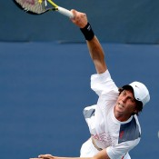 Andrew Whittington of Australia serves against Filip Peliwo of Canada during Day Eight of the 2011 US Open at the USTA Billie Jean King National Tennis Center on September 5, 2011 in the Flushing neighbourhood of the Queens borough of New York City.  (Photo by Al Bello/Getty Images)