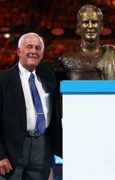 Rex Hartwig poses with his bronze bust as he is inducted into the Australian Tennis Hall of Fame at Rod Laver Arena during Australian Open 2016 at Melbourne Park; Getty Images