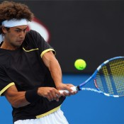 Nick Lindahl plays a backhand in his first round match during day one of the 2010 Australian Open. GETTY IMAGES