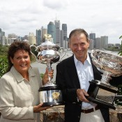 Evonne Goolagong Cawley (left) and Ashley Cooper show off the Australian Open trophies at Brisbane's Kangaroo Point Cliffs. GETTY IMAGES