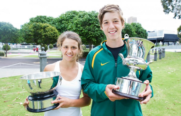 The Harris siblings, Samantha (left) and older brother Andrew celebrate winning the girls' and boys' Optus 16s Australian Championships titles.