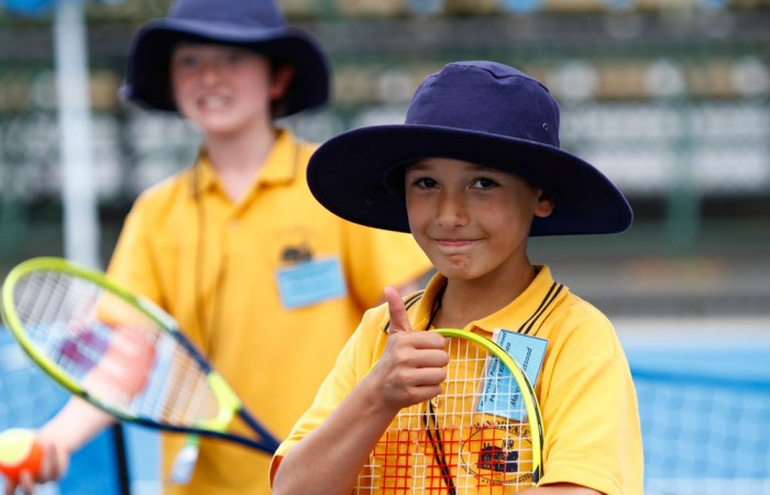 A primary school student enjoys a hit on the Melbourne Park courts during December Showdown 2010.