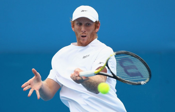 Chris Guccione plays a forehand