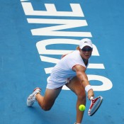 Sam Stosur stretches for a backhand in her match against Yanina Wickmayer of Belgium.