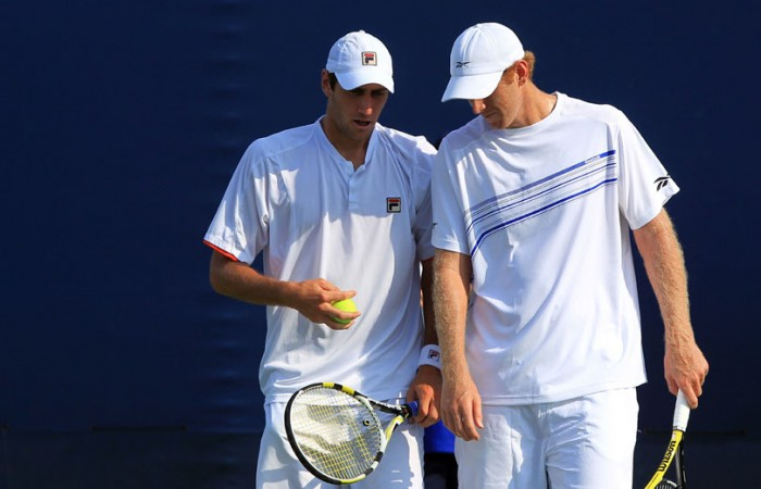 Chris Guccione and Carsten Ball talk tactics in a double match.