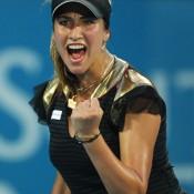 Gold-clad Frenchwoman Aravene Rezai celebrates her upset defeat of sixth-seed Jelena Jankovic.