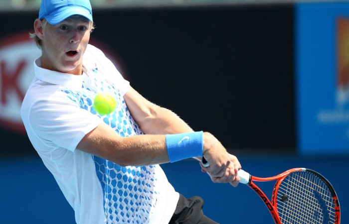 Luke Saville players a backhand at Australian Open 2011 Junior Boys' Championships.
