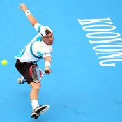 Hewitt plays improvised backhand.