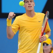 Tomas Berdych is understated in his game enhancing hand-clench.