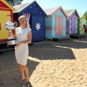 Clijsters at Brighton Beach with the Daphne Akhurst Memorial trophy.
