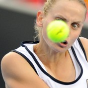Jelena Dokic has eyes for the ball in her win against Zuzana Ondraskova.