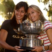 Dulko and Pennetta pose with their Australia Open women's doubles trophy.