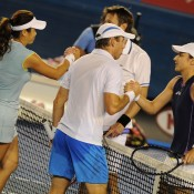 Paul Hanley and his mixed doubles partner Yung-Jan Chan shake hands after the match with winners Daniel Nestor and Katarina Srebotnik.