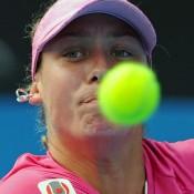 Yanina Wickmayer has her eye on the ball against Sam Stosur.