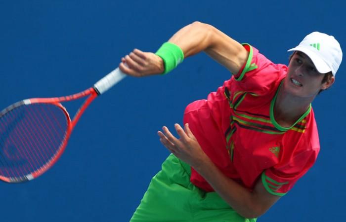 Joey Swaysland serves during his second match match at the 2011 Australian Open juniors' tournament.
