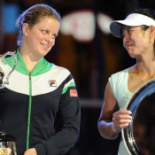 Kim Clijsters and Li Na share a look at the presentation of their trophies.