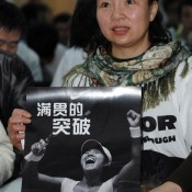 Li Na's mum in China with a poster of her daughter.