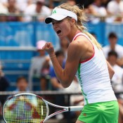 A more traditional fist pump is demonstrated by Maria Kirilenko.