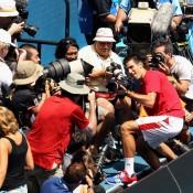 Novak Djokovic lunged into the photographers pit.
