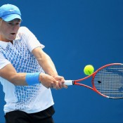 Luke Saville plays a backhand in his second match match at the 2011 Australian Open juniors' tournament.