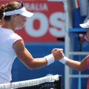 Sam Stosur muscled her way to victory against the diminutive Lauren Davis.