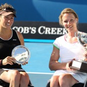 Daniela Di Toro and Esther Vergeer with their Australian Open trophies.