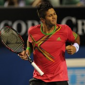 Fernando Verdasco does the double-fisted shake-ya-head party movement.