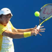Andrew Whittington plays at backhand during his second match match at the 2011 Australian Open juniors' tournament.