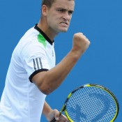 This sure is an intimidatory stare by Mikhail Youzhny as he flexes his guns.