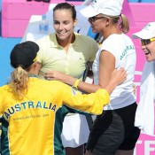 Jarmila Groth celebrates her win with the Australian Fed Cup team. Getty Images