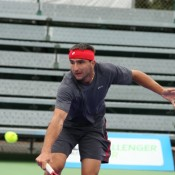 Marinko Matosevic scrambles to reach a backhand volley. Photo: Rob Hamilton