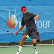 Marinko Matosevic prepares to launch a forehand return. Photo: Rob Hamilton